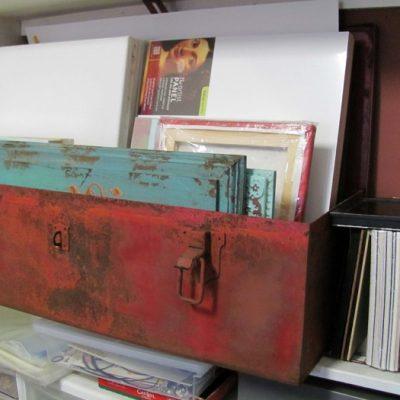 LOVE this huge old rusty red tool box to keep all my canvases in waiting in!