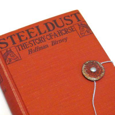 Bottlecap closure on vintage book turned journal