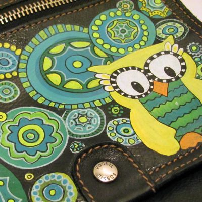 Painted owl leather Fossil purse.
