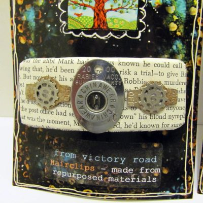 Hair barrette embellished with buttons, gears, and a rabies tag.