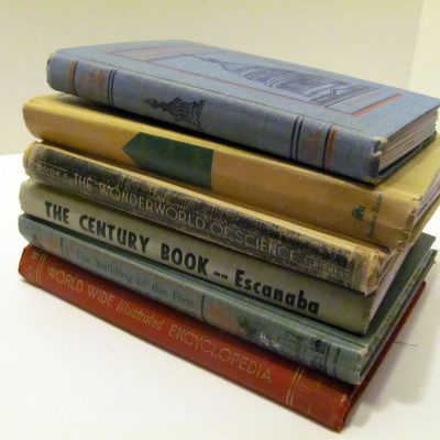 A stack of journals made from vintage book covers